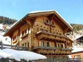 image of chalet  - Taken high in the southern alps of Switzerland just as the face of the chalet was shaded from the bright sun - JPG