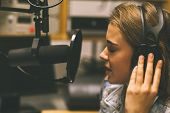 pic of recording studio  - Focused pretty singer recording a song in studio at college - JPG