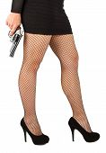 foto of fishnet stockings  - Legs of dangerous woman with handgun and black shoes fishnet stockings - JPG