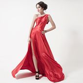 image of flutter  - Young beauty woman in fluttering red dress - JPG