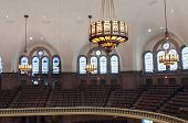 pic of church interior  - Interior of lutheran church on upper balcony showing seats lights and stained glass windows under vaulted ceilings - JPG