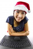 stock photo of long distance relationship  - young Asian female working or on a webcam chat during Christmas - JPG