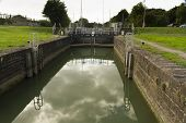 foto of coal barge  - One of two sets of locks that allow access by boat to the River Severn this is above the semi  - JPG