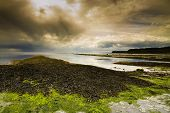 image of shale  - Kimmeridge Bay is in the Isle of Purbeck on the Dorset Coast England United Kingdom. This small bay is popular to divers and even has its own oil field (the rock shale that surrounds the bay contains enough oil to be flammable). ** Note: Shallow depth of - JPG
