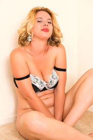 stock photo of bottomless  - Curvy young blonde bottomless in a black and white bra - JPG