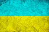 Yellow and blue destroyed Ukrainian flag as abstract background.Digitall y generated image.
