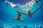foto of sky diving  - Young couple underwater in the swimming pool - JPG