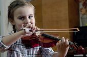 image of first class  - Adorable 3 year old little girl learning playing violin on music school class - JPG