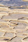 stock photo of gozo  - Salt evaporation ponds also called salterns or salt pans located near Qbajjar on the maltese Island of Gozo - JPG