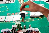 picture of gambler  - A gambler having to play not to lose his car - JPG