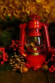 Red kerosene lamp on dark natural background