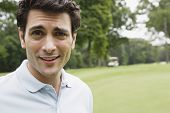 foto of cynicism  - Close up portrait of man on golf course - JPG
