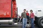 image of adoration  - Family standing by their truck - JPG