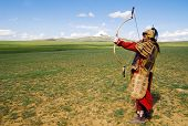 picture of armor suit  - Full armored archer aiming to shoot - JPG