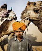 image of desert animal  - Young Indian camel guide - JPG