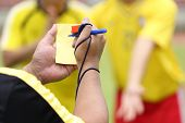 stock photo of referee  - Referee soccer recorded player foul in the game - JPG