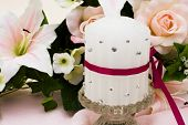 stock photo of unity candle  - A bouquet of flowers with a unity candle Unity Candle - JPG