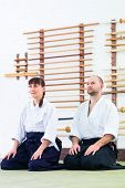 foto of aikido  - Man and woman at Aikido training in martial arts school  - JPG
