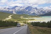 picture of recreational vehicles  - RV on a Winding Highway Next to a Mountain Lake in the Kootenay Plains  - JPG
