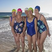 stock photo of bathing  - Group of senior women in bathing suits at beach - JPG