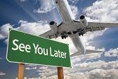stock photo of bye  - See You Later Green Road Sign and Airplane Above with Dramatic Blue Sky and Clouds - JPG