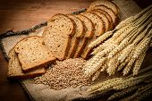 stock photo of wood pieces  - fresh bread and wheat on the wooden - JPG