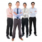 pic of southeast asian  - Portrait of group Southeast Asian businessmen standing isolated on white background - JPG