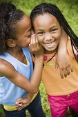 pic of pre-adolescent child  - Portrait of African girls telling secret - JPG