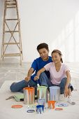 stock photo of tarp  - Asian couple with painting supplies - JPG