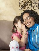 picture of middle eastern culture  - Middle Eastern girl telling grandmother a secret - JPG