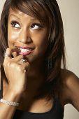 foto of flirtatious  - African American woman biting finger - JPG
