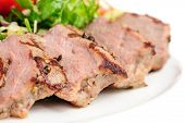foto of veal meat  - Veal meat with fresh vegetable salad - JPG