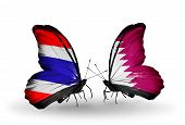 stock photo of qatar  - Two butterflies with flags on wings as symbol of relations Thailand and Qatar - JPG