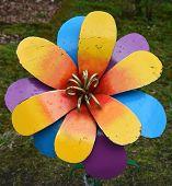 foto of metal sculpture  - Fragment of a metal flower with vivid colors - JPG