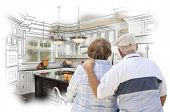 stock photo of combinations  - Senior Couple Looking Over Custom Kitchen Design Drawing and Photo Combination - JPG