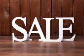 stock photo of year end sale  - Sale on wooden background - JPG