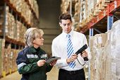 picture of dispatch  - manager and worker in warehouse with bar code scanner - JPG