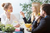 image of assemblage  - Three businesspeople on their brunch during conference - JPG