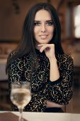 stock photo of table manners  - Portrait of an elegant woman in a fancy restaurant  - JPG