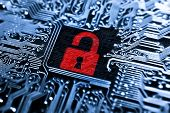 image of cybercrime  - a symbol of open red lock on computer circuit board background - JPG