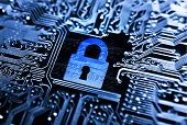 stock photo of cybercrime  - graphic symbol of a blue lock on computer circuit board background - JPG