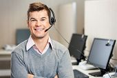 picture of telemarketing  - Portrait of confident male customer service representative with headset in call center - JPG