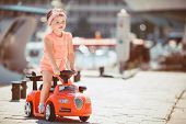 stock photo of girl toy  - Cute little girl with chestnut colored hair and short hair - JPG