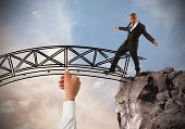pic of overcoming obstacles  - Help a businessman to overcome an obstacle - JPG