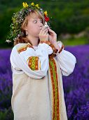 image of jock  - Funny peasant girl with eyes wide in russian national dress blows the whistle toy  - JPG