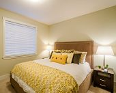 stock photo of master bedroom  - Beautiful and modern yellow bedroom in a home hotel - JPG