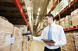 foto of warehouse  - manager worker in warehouse with bar code scanner - JPG