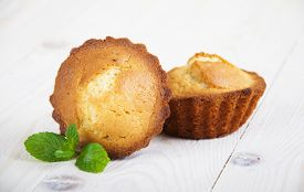stock photo of bakeshop  - Homemade Muffins Ready for Breakfast on wooden background - JPG