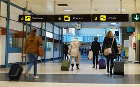 picture of lineup  - Women Airline Passengers in an Airport - JPG