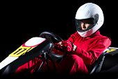 stock photo of karts  - Young woman karting racer isolated - JPG